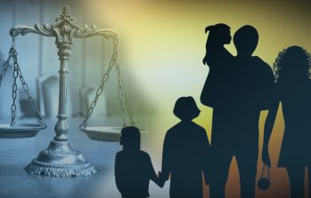 a family in front of a legal scale