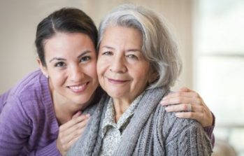 elderly women with her adult daughter